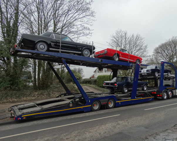 classic cars on vehicle transporter